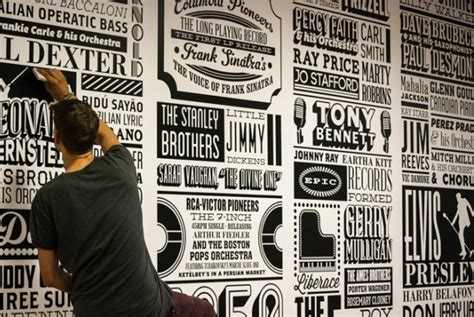 song on a hill traces of black and blue books sony traces its company history through typographic mural