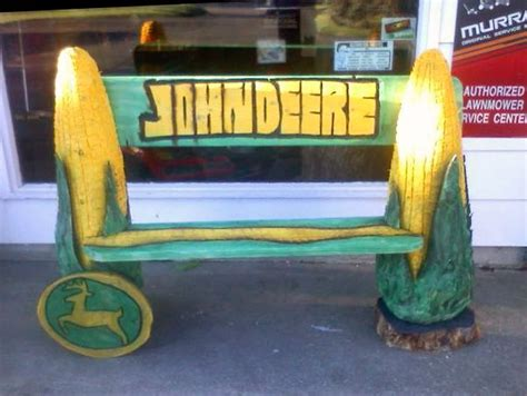 john deere bench john deere bench created by chainsaw carving artist chuck