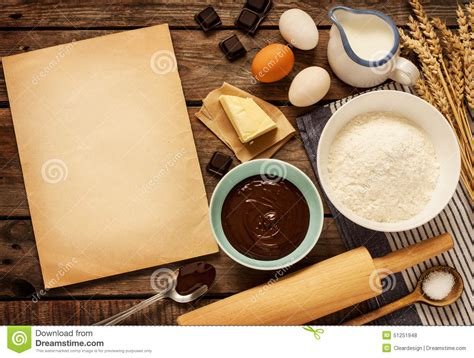 four ingredient cookbook books baking chocolate cake ingredients and blank paper
