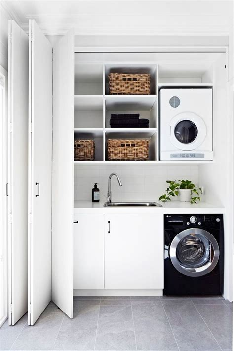 laundry joinery design concertina doors in the hallway conceal a small but