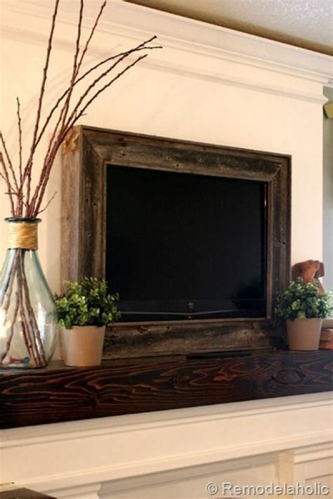 tips for hanging a flat screen tv over a fireplace frame the tv