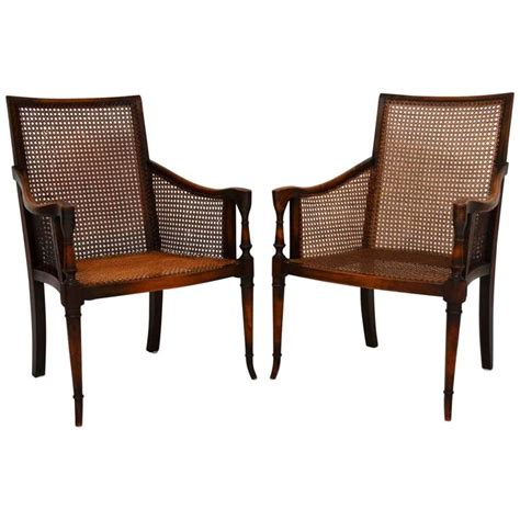 cane armchairs vintage pair of antique mahogany and cane armchairs at 1stdibs