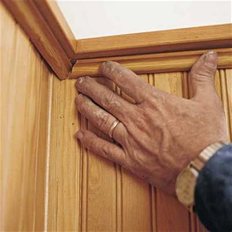 how to hang beadboard paneling installing wainscoting panels on ceiling