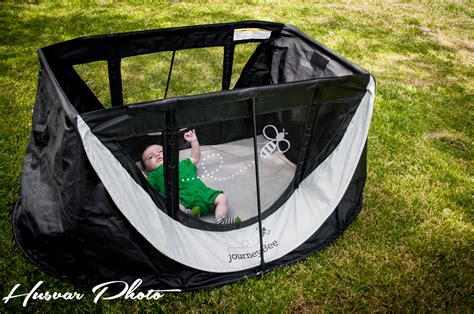 a modern portable crib journeybee giveaway in the