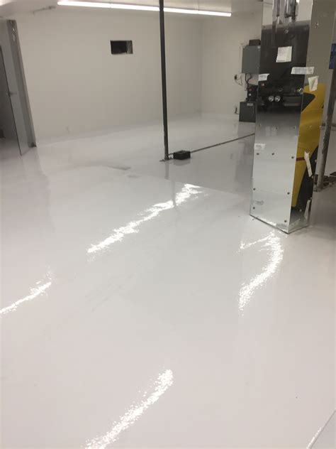 white epoxy floor for exotic car garage in thornhill epoxyguys
