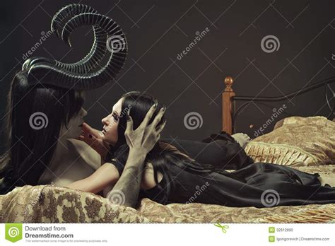 In Bed With The Devil Stock Photo Image 32612890