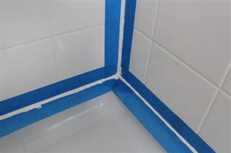 bathroom caulking tips tape off for caulking the tub and shower diy pinterest