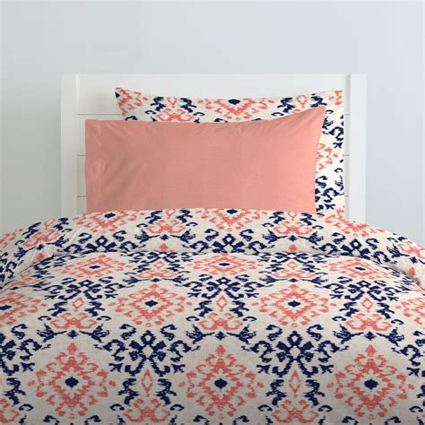 coral navy bedding navy and coral ikat kids bedding carousel designs