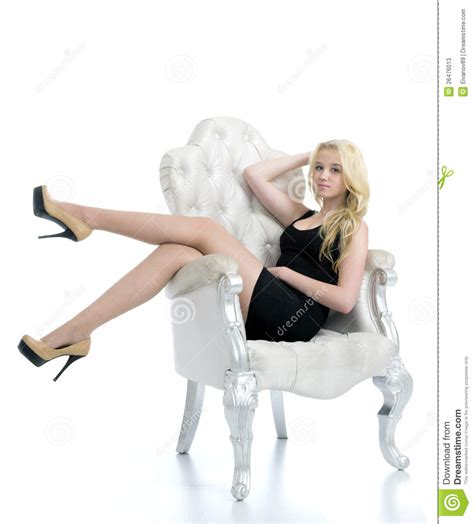 woman in armchair stunning young blonde woman lying in armchair stock photos