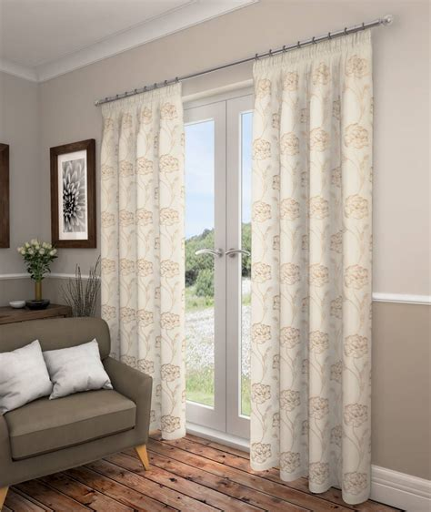 cream and gold voile curtains swindon cream voile with gold design lined curtains net