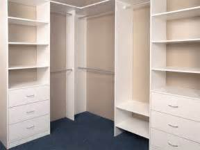 White wooden custom made built in wardrobe with multi drawer storage