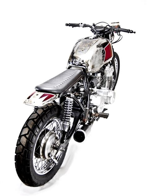 Instead Of Reaching For The Same Lbd Stand Out In At Fetes In A Festive White Frock With Black Accents Fashiontribes Fashion by The Essential Buying Guide For The Honda Cb750