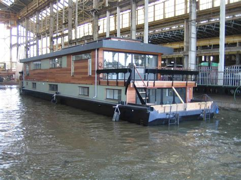 Houseboats by Dirkmarine   all custom designed   steel