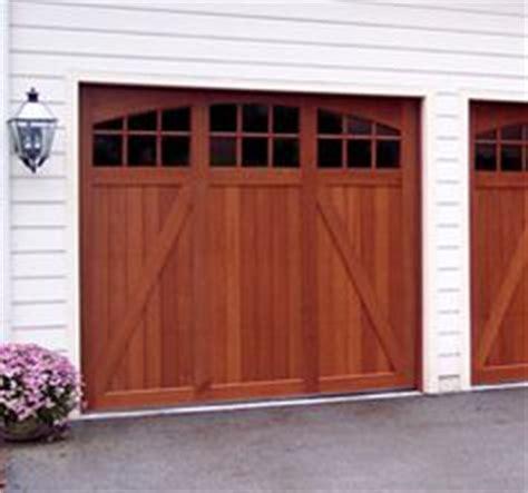 Hillsborough Garage Door Clopay Coachman Collection White Steel Carriage Style Garage Doors Design 22 With Sq23 Windows