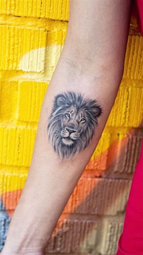 small lion tattoo designs smaller and different placement though