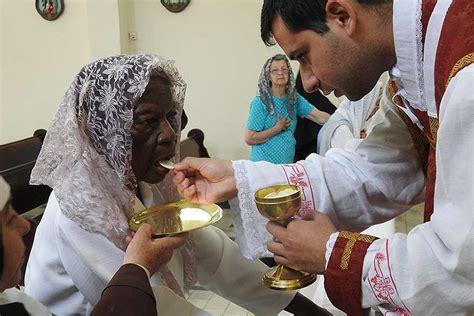 101 year receives communion catholic