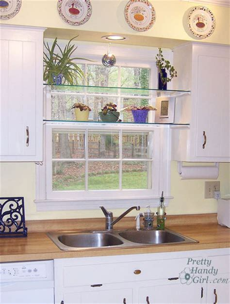 install glass shelves to add planters to your kitchen