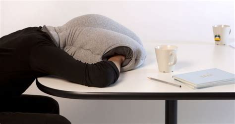 desk pillow nap ostrich pillow allows workers to sleep on the metro news