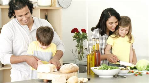 Happy In The Kitchen A Dinner A Signing by Footage In High Definition Of Happy Family Preparing A