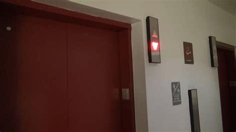 modernized otis traction elevators   red garage