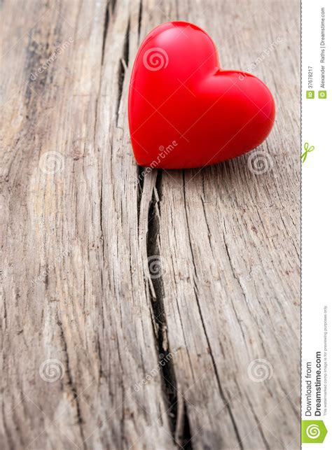 red heart  crack  wooden plank royalty  stock