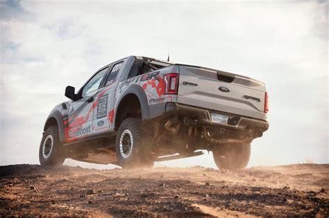 ford   raptor enters    desert  road