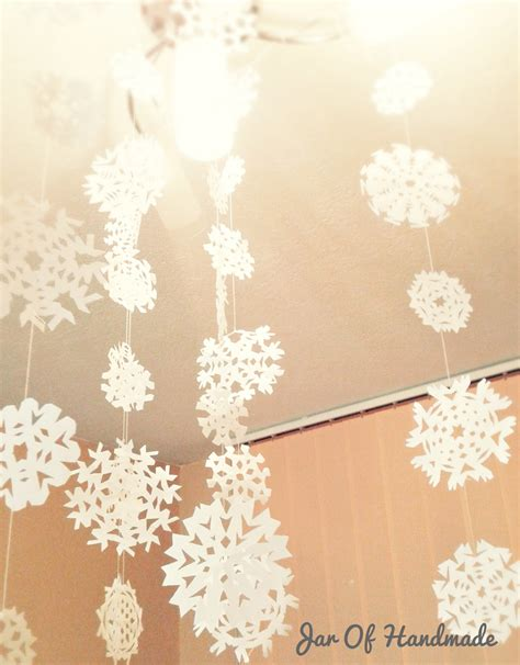 jar of handmade diy paper snowflakes hanging from the