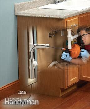 what can i pour my sink to unclog it unclog a kitchen sink the family handyman