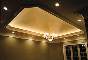 recessed lighting and tray ceiling with light rope cove