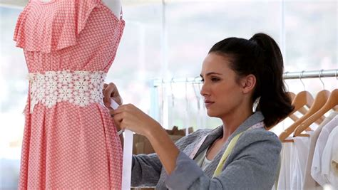design clothes pictures hispanic woman at work as fashion designer and tailor