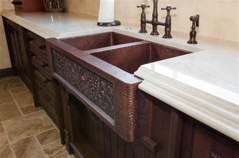 Charming Copper Kitchen Countertops #2: Vine-design-on-copper-sink.jpg