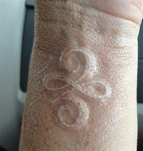 infinity tattoo in white ink 30 attractive white ink wrist tattoo designs golfian com