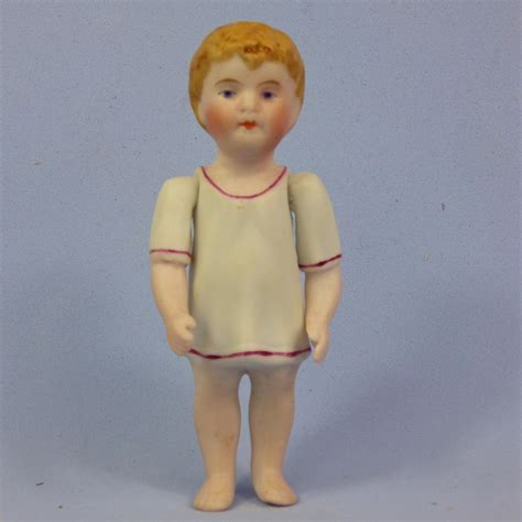 early bisque doll early all bisque boy doll in molded shirt jointed arms