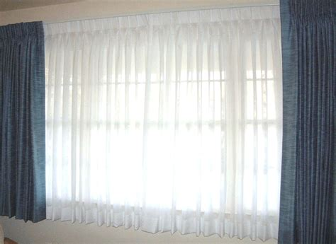 window drapery ideas white sheer curtain and blue drapery curtain covering large glass window interior charming