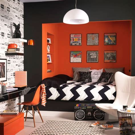 rock and roll bedroom ideas black and white bedroom with orange feature wall how to
