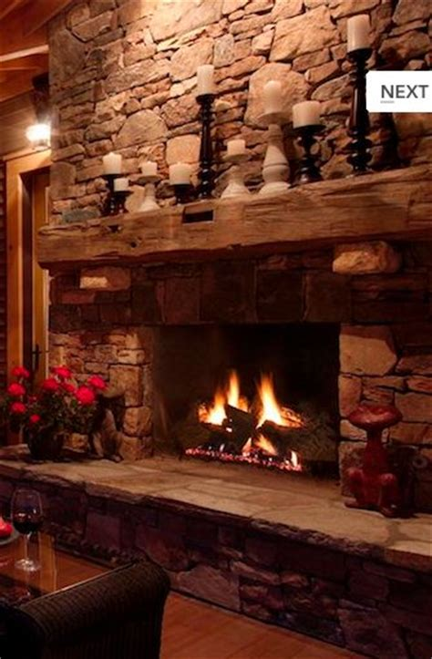rustic stone fireplaces love the old timber used for the fireplace mantle i have