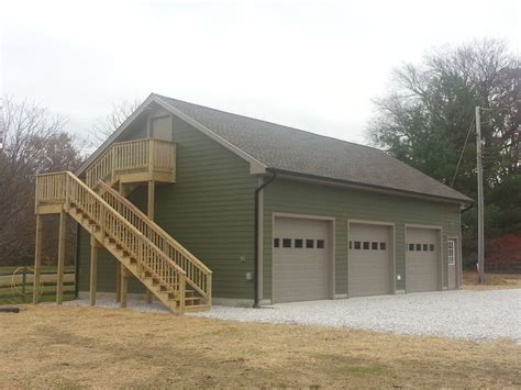 3 car garage with loft exterior stairs leading to loft office in new 3 car garage