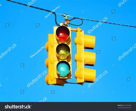 blue lights on traffic lights american yellow traffic lights isolated on stock photo