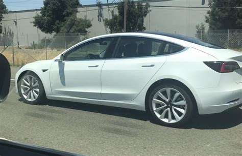 tesla outside white tesla model 3 spotted outside fremont looks