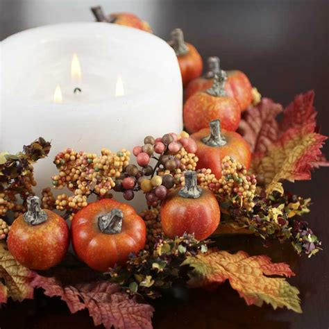 fall artificial pumpkin and berry wreath candles and