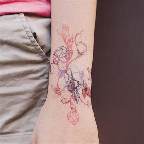 delicate flower tattoo designs tinny five petaled flowers with vein leaves