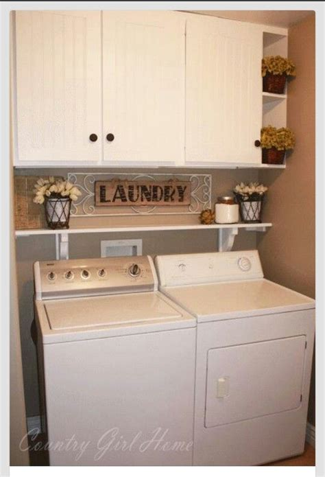 cabinets above washer dryer cabinets laundry closet and dryers on pinterest