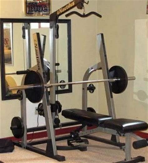 bench press lats bench press lats nautilus squat rack lat tower adjust