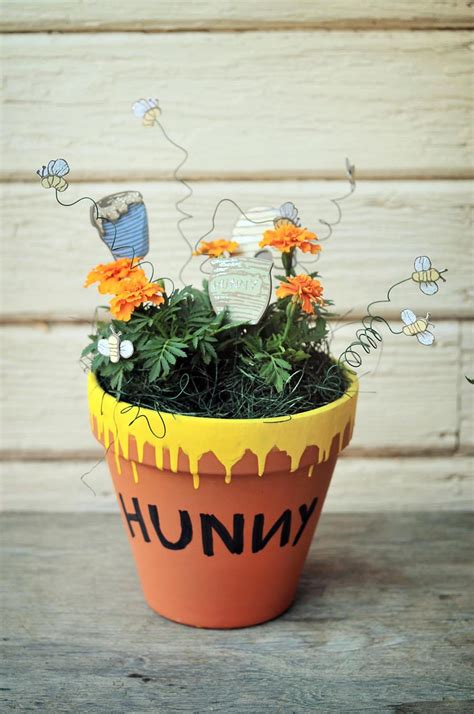 winnie the pooh centerpiece ideas hunny pots and pooh sticks winnie the pooh baby shower
