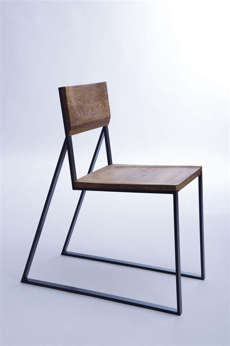 Wood And Steel Furniture by Sharp Lines Of A Metal Frame Contrast With The