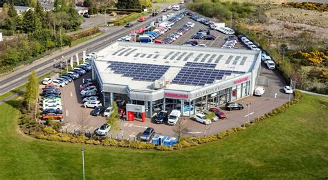 aerial view of dealership scottish nissan dealership clocks up a noble 85 years