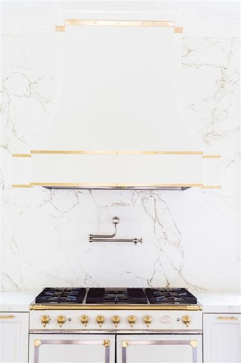 white and gold kitchen features white cabinets adorned the world s catalog of ideas