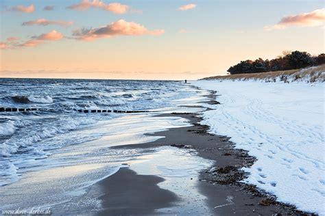 winter beach stroll baltic sea germany dave derbis