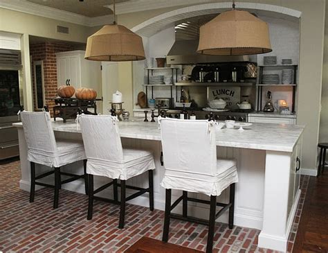 white wood brick floors and basket lights