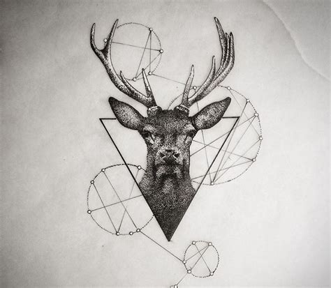 dotwork deer portrait with geometric drawings tattoo